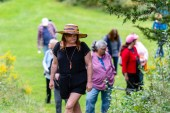 WOODBURY, CT. 23 September 2018-092318 - Kiri Clark, in the hat, leads a group of people in a therapeutic journey through the woods at the Flanders Nature Center Van Vleck Sanctuary in Woodbury on Sunday. Bill Shettle Republican-American
