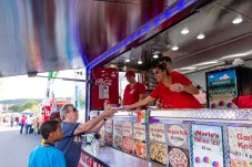 NAUGATUCK, CT. 29 September 2018-092918 - Al Petitti of Waterbury, left gets handed a slice of pizza from Luzi Trepca of Ansonia, from the Marios Pizza Truck during the third annual Ion Bank/Mission 22 Fall Festival on Maple Street and Rubber Avenue in Downtown Naugatuck on Saturday. Bill Shettle Republican-American
