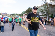 NAUGATUCK, CT. 29 September 2018-092918 - US Army and Vietnam Veteran Pete Ruggeri marches up maple street during the third annual Ion Bank/Mission 22 Fall Festival in downtown Naugatuck on Saturday. Bill Shettle Republican-American