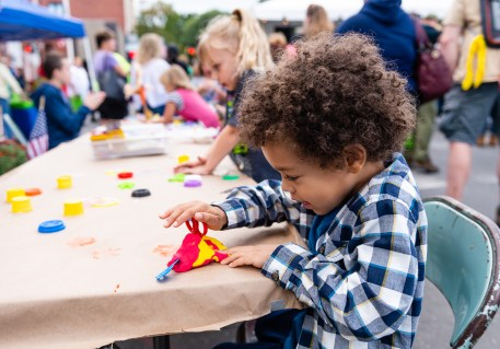 NAUGATUCK, CT. 29 September 2018-092918 - Major Dennis, 5, of New Haven has fun with his play dough during the third annual Ion Bank/Mission 22 Fall Festival in downtown Naugatuck on Saturday. Bill Shettle Republican-American