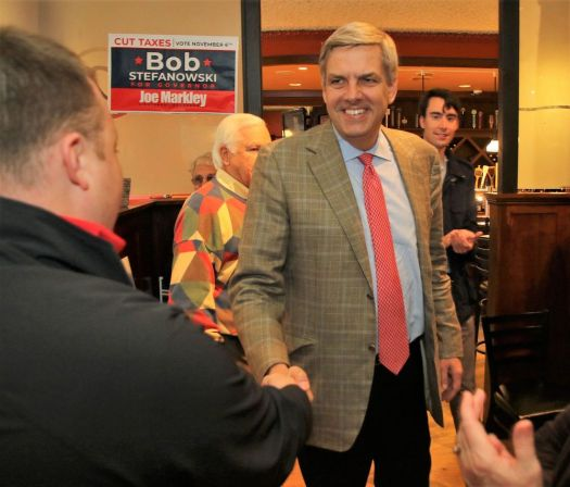 Bob Stefanowski, the Republican candidate for governor, is greeted by supporter Christopher Parkhurst of Morris upon his arrival for a campaign rally at The Corner restaurant in Litchfield on Friday. John McKenna Republican-American