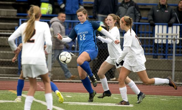 WEST HAVEN, CT-111818JS09- Lewis Mills' Grace Kryzanski (22) pushes the ball through a group of Plainfield defenders during their Class M soccer championship game Sunday at West Haven High School. Jim Shannon Republican American