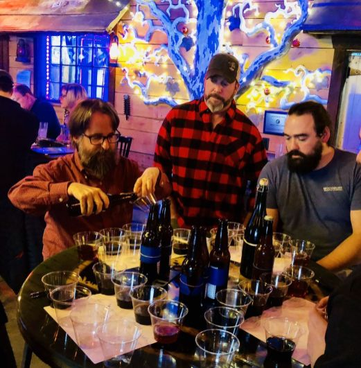 cutline attribution name:Steve Bigham Republican-AmericanWoodbury Brewing Co. owner Alan Cetrone, center, looks on as judges Will Siss, left, and brewmaster Ben Gardner carry out Sunday's taste test during the Woodbury Brewing's first home brewers competition Sunday in Woodbury.