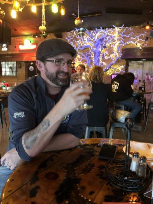 Third-place finisher Tim Phelps entered a creek beer, a cherry juice-based lambic in Woodbury Brewing Company's first home brewers competition Sunday in Woodbury.Steve Bigham Republican-American