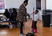 Kuwaysah Thomas, 6, right, helps with the clean up/cleanup by sweeping into a dustpan held by Girls Inc Program Facilitator Shaniqua Dillard during playtime hour in an after school program at the Girls Inc in Waterbury on Friday. Bill Shettle Republican-American
