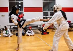First degree black-belt Lauren Tuck, 14, left, and white-belt Tajane Angus, 12, spar together, during an after school program at the Girls Inc in Waterbury on Thursday. Bill Shettle Republican-American