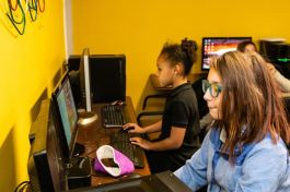 Mia Hernandez, 11, right, and Gabriella Feaggins, 8, play at the computer stations during playtime hour in an after school program at the Girls Inc in Waterbury on Friday. Bill Shettle Republican-American