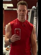 A selfie shows the toning Mark Garrison has achieved from years working out at the gym.