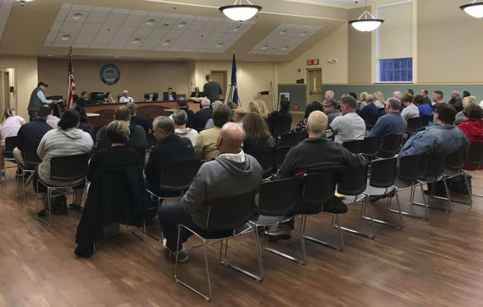 More than 100 people attend a Torrington Inland Wetlands Commission meeting Tuesday evening regarding a proposal to build an apartment complex in the Greenbrier Estates subdivision off Route 202 near the Litchfield line. Bruno Matarazzo Jr. Republican-American