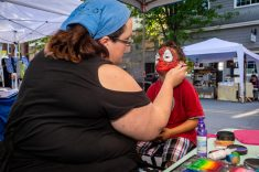 NAUGATUCK, CT. 18 May 2019-051819 - Lonnie DiNello of Faces by Lonnie, left, puts the finishing touches of painting Ricardo Vera, 4, of Naugatuck, as spiderman, during the annual Ion Bank/Naugatuck Spring Festival on Church Street in Naugatuck on Saturday. Bill Shettle Republican-American