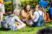 NAUGATUCK, CT. 18 May 2019-051819 - Jennifer Anderson, center, sits on the grass sharing a funny moment as she has lunch with her daughters Katheryn Blanchard, left, and Emily Blanchard, right, all of Naugatuck, during the annual Ion Bank/Naugatuck Spring Festival on Church Street in Naugatuck on Saturday. Bill Shettle Republican-American