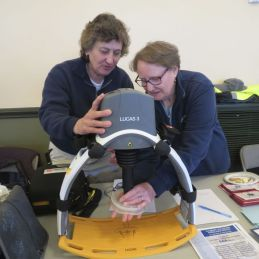 Jacquie Rice, left, and Deb Fails, members of Salisbury Volunteer Ambulance Association, demonstrate the LUCAS 3, a chest-compression system, during Volunteer Fair in Salisbury on Saturday. Ruth Epstein Republican-American