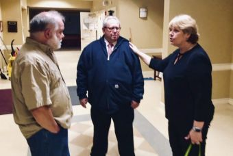 Region 14 Board of Education Chairman Janet Morgan, right, welcomes Tuesday's referendum results with Woodbury resident Ed DeCortin, left, and Region 14 finance director Wayne McCallister. Steve Bigham Republican-American
