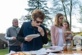 A woman looks over the many varieties of pizza to choose from, during the Greater Waterbury Campership Fund Big Green Truck Pizza Party at Camp Mataucha in Watertown on Thursday. Bill Shettle Republican-American