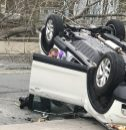 A white SUV flipped over on Route 44 in Winchester near the Dunkin Donuts. on Wednesday morning Contributed