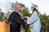 Oxford High School Salutatorian Madeline Kondic gets her diploma from Assistant Principal Robert Schumann during commencement ceremonies at Oxford High School on June 11, 2019. Bill Shettle/Republican-American