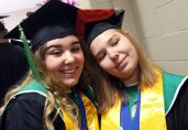 Roma Rositani, 17, and hers sister Sofia Rositani, 18, graduate during the Wilby High graduation at the Palace Theater in Waterbury Friday. Steven Valenti Republican-American