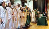 Graduates line up on stage Wednesday during the Wilby High School graduation in Waterbury.Steven Valenti Republican-American
