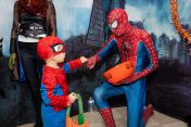 SOUTHBURY, CT. 26 October 2019-102619BS384 - Little Spiderman Joel Finch, 3, of Oxford, left, fists pumps another spiderman Jackson Masi, of Southbury in the Marvel Heroes themed room, during the ninth Annual Trick-or-Treat Spooktacular at the Southbury Center Firehouse on Saturday. The firehouse was transformed into a maze of different themed-rooms where kids could collect treats. Bill Shettle Republican-American