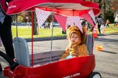 SOUTHBURY, CT. 26 October 2019-102619BS391 - Luca Coelho, 16 months old of Watertown sits in his makeshift cage waiting in line, during the ninth Annual Trick-or-Treat Spooktacular at the Southbury Center Firehouse on Saturday. The firehouse was transformed into a maze of different themed-rooms where kids could collect treats. Bill Shettle Republican-American