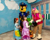 SOUTHBURY, CT. 26 October 2019-102619BS378 - From second from left, Chase, and Skye of PAW Patrol, greet sisters Rosalie, 4, and Filomena Carrieri, 6, both of Southbury with treats, during the ninth Annual Trick-or-Treat Spooktacular at the Southbury Center Firehouse on Saturday. The firehouse was transformed into a maze of different-themed rooms where kids could collect treats. Bill Shettle Republican-American