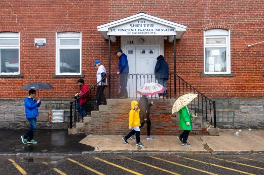 WATERBURY, CT. 27 October 2019-102719BS708 - Walkers walk out of the Shelter, during the eleventh annual walk and race fundraiser for the St. Vincent DePaul Mission of Waterbury on Sunday. The Walk took the participants through the St. Vincent DePaul Mission's Thrift Store, Soup Kitchen, and Shelter, the same facilities where the poor receive clothing, food, and a place to sleep, with the guidance of Mission staff. Bill Shettle Republican-American
