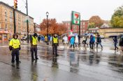 WATERBURY, CT. 27 October 2019-102719BS694 - Waterbury Police Explorers, from left, Junior Roldan, 13, Haley Ortiz, 15, and her brother Michael, 13, stand in the pouring rain helping with traffic control, during the eleventh annual walk and race fundraiser for the St. Vincent DePaul Mission of Waterbury at downtown Waterbury on Sunday. The Walk took the participants through the St. Vincent DePaul Mission's Thrift Store, Soup Kitchen, and Shelter, the same facilities where the poor receive clothing, food, and a place to sleep, with the guidance of Mission staff. Bill Shettle Republican-American