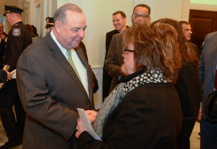 WATERBURY, CT-120119JS14- Waterbury Mayor Neil M. O'Leary is greeted by friends and supporters, including Sue McGrath of Waterbury, following the inauguration for newly elected and re-elected officials Sunday at Waterbury City Hall. Jim Shannon Republican-American