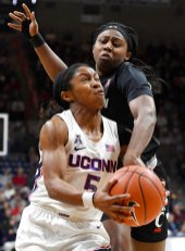 Connecticut's Crystal Dangerfield, left, is pressured by Cincinnati's Chellia Watson in the first half of an NCAA college basketball game, Thursday, Jan. 30, 2020, in Storrs, Conn. (AP Photo/Jessica Hill)