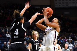 Connecticut's Megan Walker, right, shoots over Cincinnati's Angel Rizor in the first half of an NCAA college basketball game, Thursday, Jan. 30, 2020, in Storrs, Conn. (AP Photo/Jessica Hill)