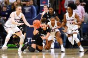 Cincinnati's Angel Rizor, center left, tries to pass the ball she grabbed under pressure from Connecticut's Anna Makurat (24), Aubrey Griffin (44) and Christyn Williams (13) in the second half of an NCAA college basketball game, Thursday, Jan. 30, 2020, in Storrs, Conn. (AP Photo/Jessica Hill)