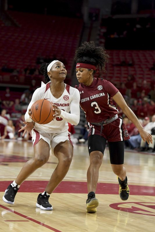 Arkansas guard Makayla Danielstries to drive past South Carolina defender Destanni Henderson (3)) during the first half of an NCAA college basketball game Thursday, Feb. 6, 2020, in Fayetteville, Ark. (AP Photo/Michael Woods)