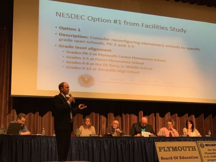 Plymouth Superintendent Martin Semmel explains to residents where the Board of Education stands regarding the best use of facilities study before beginning a hearing Thursday night in the Terryville High School auditorium. Jacqueline Stoughton/Republican-American