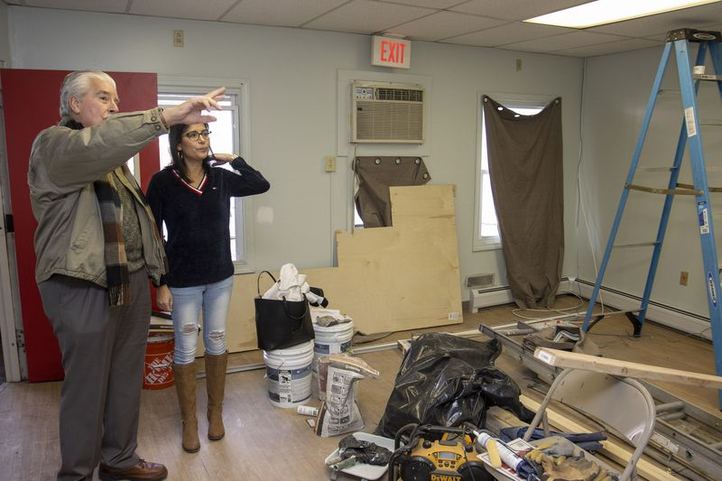 WATERBURY, CT - 29 FEBRUARY 2020 - 022920JW10.jpg -- Building owner Ralph Monti talks with Program Director, Belinda Arce-Lopez about some of the renovations that will happen that will allow the CHD Hospitality Center to move into it