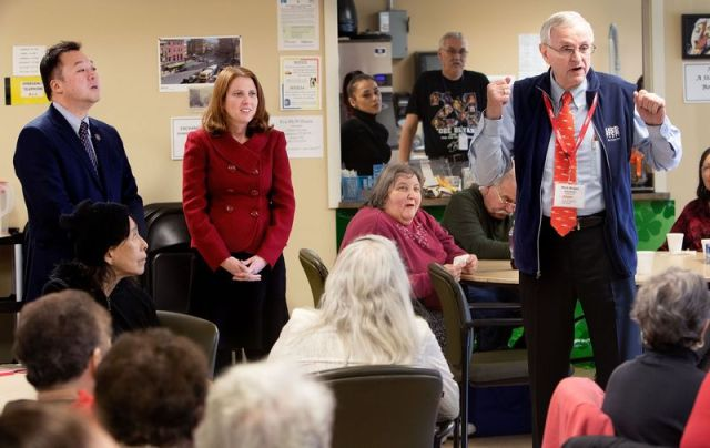 WATERBURY CT. - 03 March 2020-030320SV06-From left, Attorney General William Tong and Department of Consumer Protection Commissioner Michelle H. Seagull listen to Rich Bright of AARP talk to seniors during a visit to the senior center in Waterbury Tuesday.Steven Valenti Republican-American