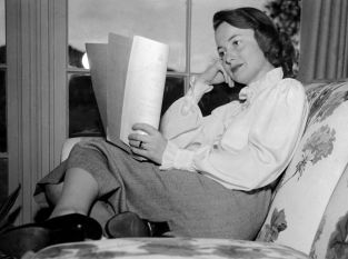 In this April 16, 1948, photo, actress Olivia DeHavilland studies a script. (Associated Press)
