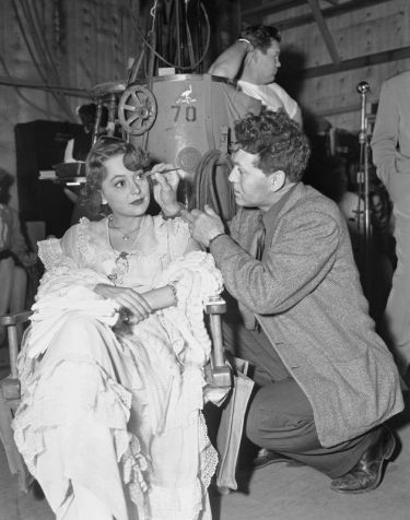 """In 1946, Olivia de Havilland has make-up applied on the set of the movie """"To Each His Own."""" De Havilland won an Academy Award for her performance in the movie. (Associated Press)"""