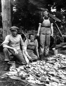 Myra Gifford (centre) with one day's rat catch