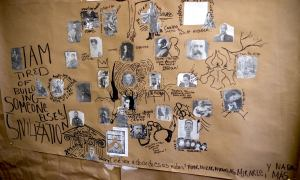"""A mixed-media collage appears on a piece of what appears to be butcher paper. A cluster of printed-out black-and-white photographs of writers and artists appear surrounded by drawings and writing made in black permanent marker. The following figures appear surrounded by quotations: Fenton Johnson, followed in large text by """"I am tired of building someone else's civilization"""" and flanked by a photo of Paul Laurence Dunbar; Marc Chagall inside the quote """"Then the angel led me to the river of the water o' life"""" with angels' wings drawn on his back; next to a self-portrait by painter Kerry James Marshall titled """"The Invisible Man""""; next to a photograph of Jean-Michel Basquiat with his signature crown drawn above his head next to a rendering of the tree from Van Gogh's starry night next to a self-portrait of Vincent Van Gogh; above a photo of a young Franz Kafka with a beetle drawn over half his face; above a painting of Toulouse-Lautrec next to a drawing of a high-heeled leg between a photo of Herman Melville below the words """"I prefer not to"""" and a photo of Zora Neale Hurston next to the words """"Laugh to Keep from Crying"""" (Hughes); above a photo of Henry David Thoreau with an unshackled handcuff coming from his drawing next to the words """"Do you know what makes the prison door disappear?""""; adjacent to an image of Richard Wright cut out of a picture of a library and pasted back on it, leaving a brown silhouette behind him; next to a drawing of Federico García Lorca inside a drawing of the Parthenon with the words """"Quemaré el Partenón para por la noche""""; next to the words """"Qué voy a decir de esas nubes? Mirar, mirar, mirarlas, mirarle, y nada más."""" Above these words, the Rolling Stones appear next to the words """"Gimme sum Sugar!"""" below a drawing of Nina Simone with musical notes drawn around her. Above her are two photos, one of Simon & Garfunkel, the other of Romare Bearden; next to Bearden is a photo of Georgia O'Keefe beneath a drawing of one of her flowers next to a phot"""