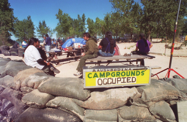 The blockade to the entrance to Ipperwash Beach in 1995, near where a Dudley George was shot by police.(source redpowermedia)