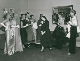 """""""Oct. 18, 1955; Mrs. Mamie Eisenhower bids adieu to the Daniel and Fisher fashion show models at the Fitzsimons Army Hospital's Officer's Wives Club."""""""