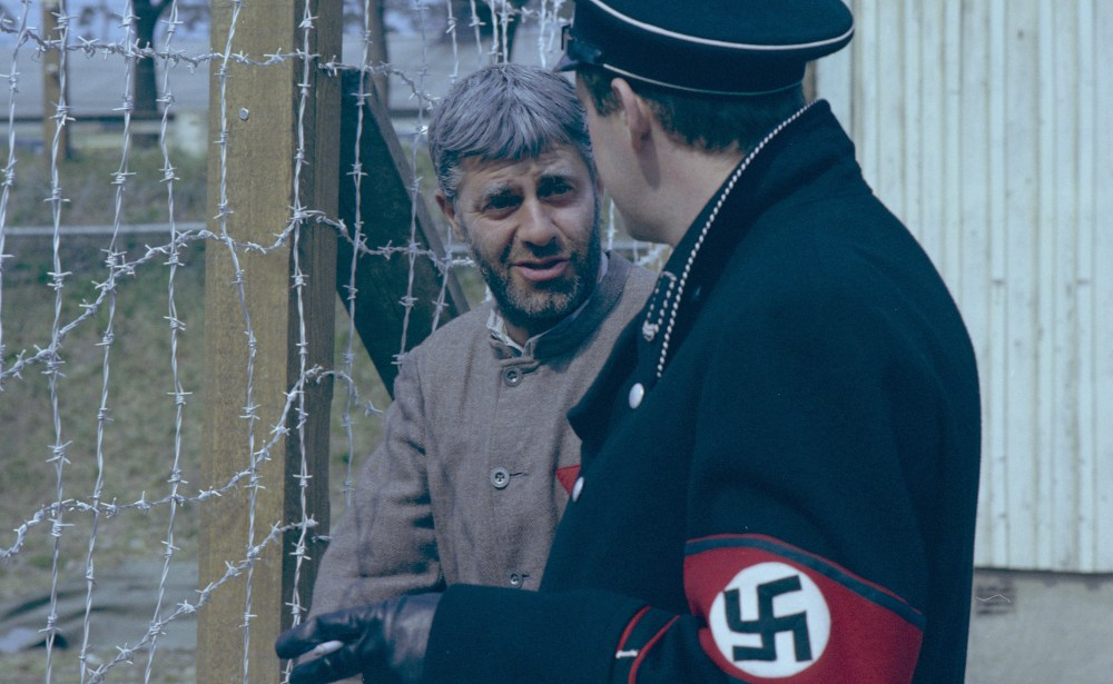 Lewis talking to a Nazi S.S. Officer. It remains unseen if he was in character or directing at this point in time.Photo: Roger Tillberg, Archive: The Swedish Film Institute