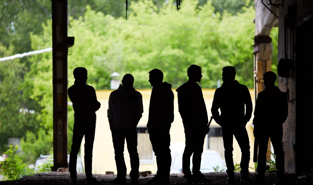 group of gangster youth standing outdoors