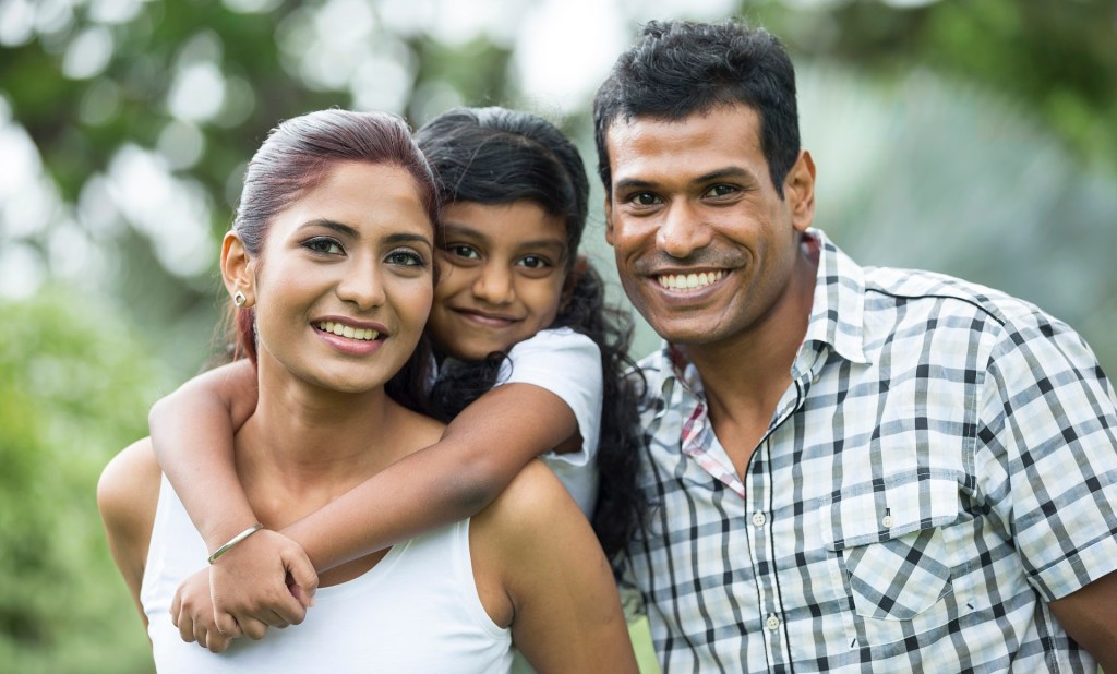 Happy Indian family at the park