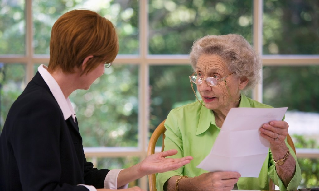 Senior woman getting information on community resources from an agent