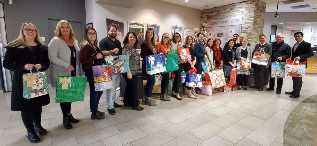 Archway staff with gifts for clients of the Youth Angel Tree progect