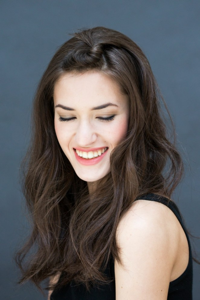 black hair, black dress, adorable smile, pink lipstick, do hairstyles for long hair yourself