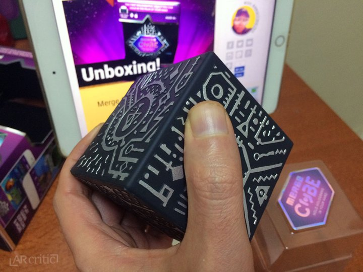 Holding the Merge Cube in my hand