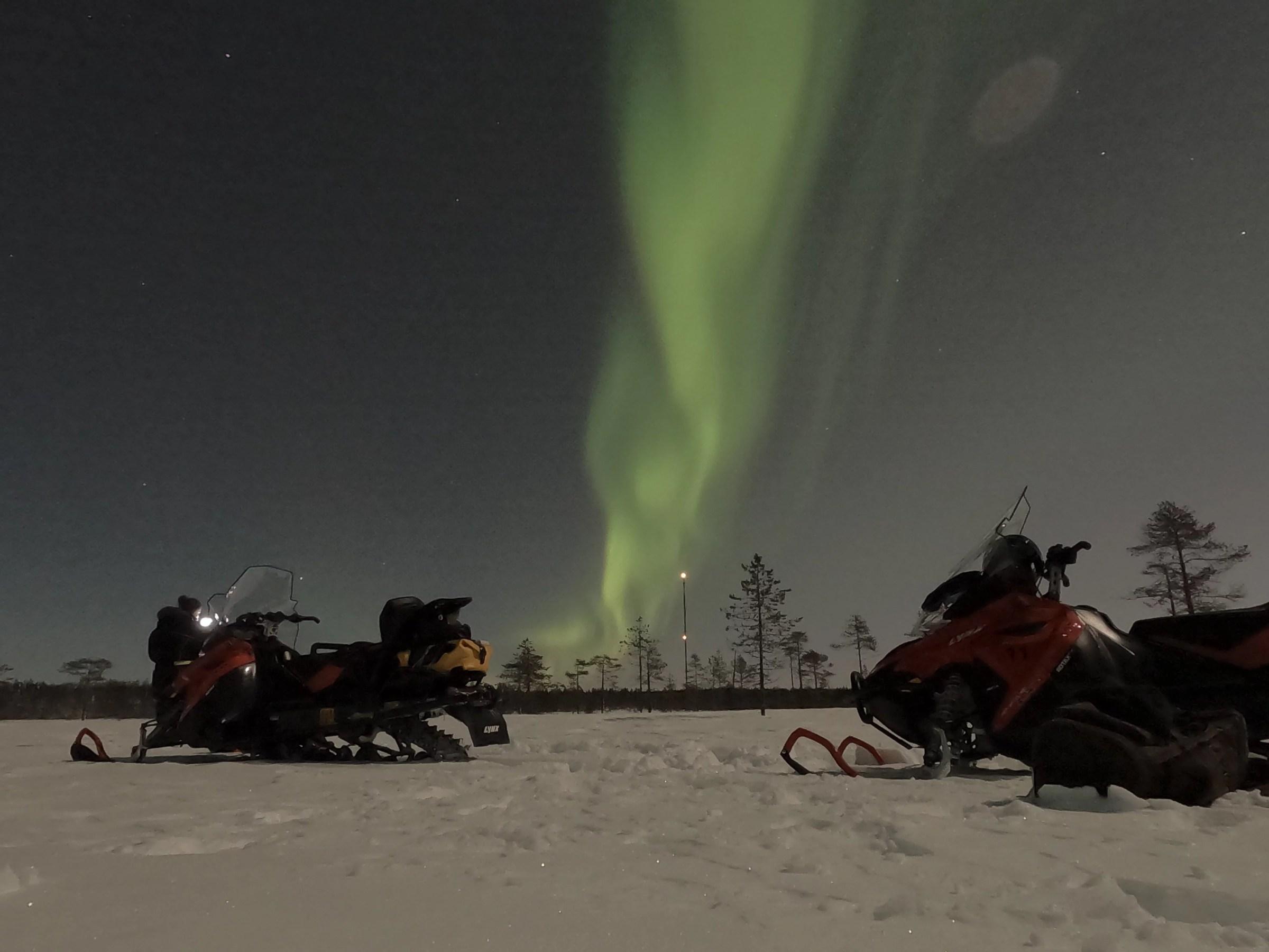 northern light by snowmobile rovaniemi