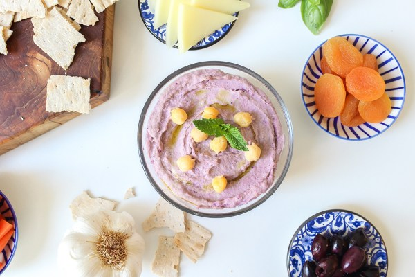 Homemade purple healthy wild Arctic Flavors blueberry hummus served with appetizers, also called meze